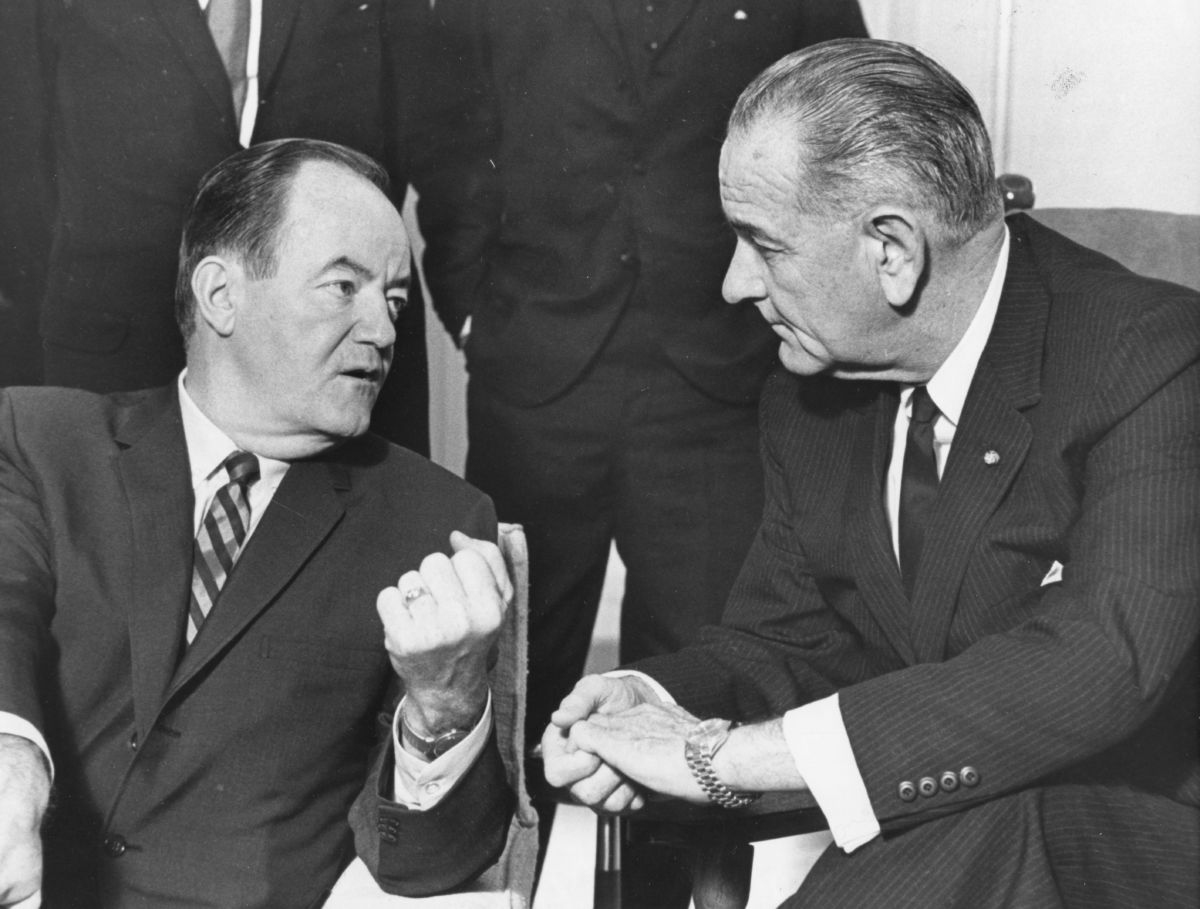 President Lyndon B Johnson listens to Vice-President Hubert H Humphrey's report of his five-day Far East tour, Washington DC, January 3, 1966. (Photo by PhotoQuest/Getty Images)