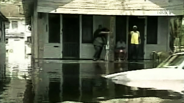 New Orleans residents deal with floodwaters in the aftermath of Hurricane Katrina in 2005.