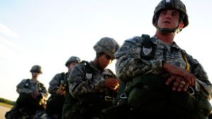 U.S. Army soldiers assigned to the 82nd Airborne Division walk onto a C-17 Globemaster III aircraft prior to a parachute drop during a joint forcible entry exercise at Pope Air Force Base, N.C., on Sept. 14, 2010. A joint forcible entry exercise is held six times a year to enhance cohesiveness between the Air Force and the Army. DoD photo by Staff Sgt. Angelita M. Lawrence, U.S. Air Force.