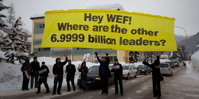 Protesters from the Occupy anti-capitalist movement release a banner reading ' Hey WEF! Where are the other 6.9999 billion leaders?' January 2012. (AP Photo/Anja Niedringhaus)