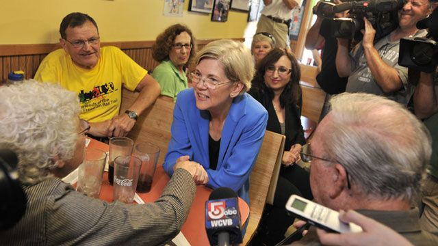 Harvard Law professor and consumer advocate, Democrat Elizabeth Warren talks with supporters at the J & M Diner in Framingham, Mass. September 2011. (AP Photo/Josh Reynolds)