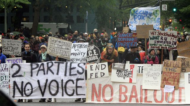 Protesters form a wall of signs at the Occupy Portland camp in downtown Portland, Ore. October 2011. (AP Photo/Don Ryan)