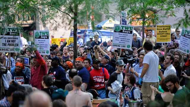 Members of Local 100 of the Transport Workers enter Zuccotti Park in support of the Wall Street protestors in New York. September 2011(AP Photo/Louis Lanzano)