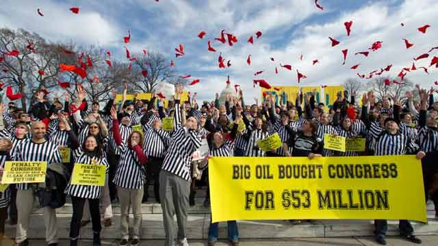 Protestors against the Keystone XL pipeline dressed as referees throw red penalty flags during a rally on Capitol Hill in Washington. Jaunary 2012. (AP Photo/Manuel Balce Ceneta)