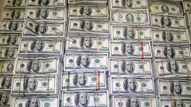 Piles of U.S. currency. March 2007. (AP Photo/PGR-HO)