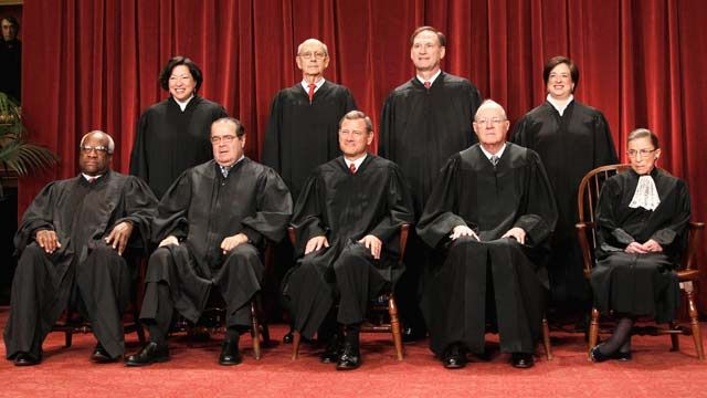 Members of the Supreme Court gather for a group portrait at the Supreme Court in Washington before the start of the 2010 session. October 2010. (AP Photo/Pablo Martinez Monsivais, File)