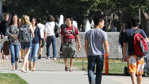 Students walk through the campus of Claremont McKenna College in Claremont, Calif. February 2012. (AP Photo/Reed Saxon)
