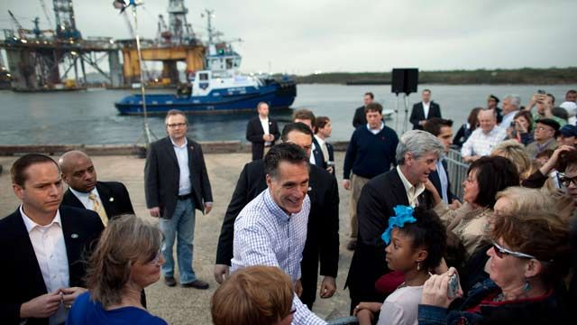 Republican presidential candidate Mitt Romney shakes hands during a campaign stop at the Port of Pascagoula, Miss. March 2012. (AP Photo/Evan Vucci)