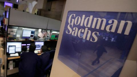 Traders work in the Goldman Sachs booth on the floor of the New York Stock Exchange. March 2012. (AP Photo/Richard Drew)