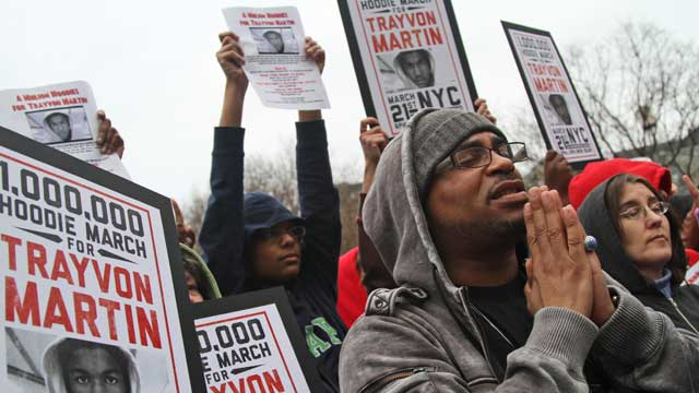 Demonstrators pray during the Million Hoodie March in Union Square Wednesday, March 21, 2012 in New York. (AP Photo/Mary Altaffer)