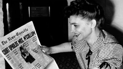 Vashti McCollum smiles as she reads of her victory before the U.S. Supreme Court in her suit to bar religious eduction from the Champaign high schools. March 1948. (AP Photo)