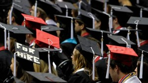 Students attend graduation ceremonies at the University of Alabama in Tuscaloosa, Alabama. (Photo by Butch Dill/AP)