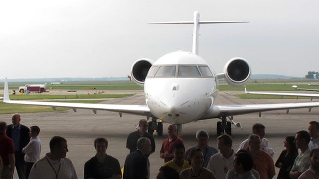 Employees of Rockwell Collins, Inc. gathered at an airport hangar before a rally in Cedar Rapids, Iowa. August 201. (AP /Ryan J. Foley)