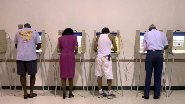 Voters mark their ballots during Florida's primary elections. September 2002. (AP photo/Oscar Sosa)