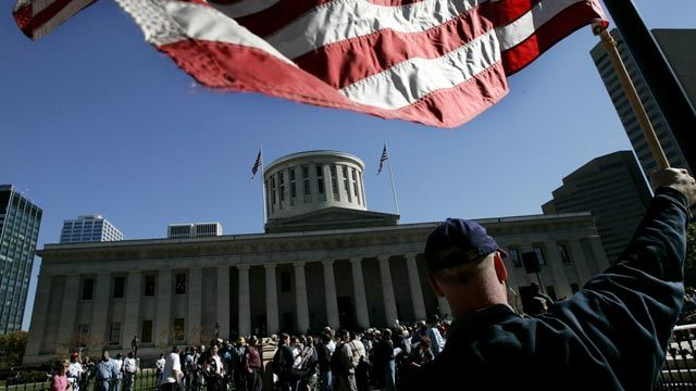People gather at the state capitol building in Columbus, Ohio following a 2004 march sponsored by the Ohio Voter Protection Coalition. October 2004. (AP Photo/Laura Rauch)