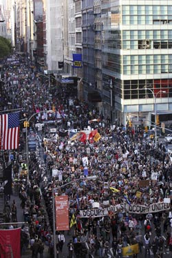 Protesters march down Broadway toward the financial district in New York, Tuesday, May 1, 2012. Hundreds of activists with a variety of causes spread out over New York City on International Workers Day, or May Day, with Occupy Wall Street members leading a charge against financial institutions. (AP Photo/Seth Wenig)