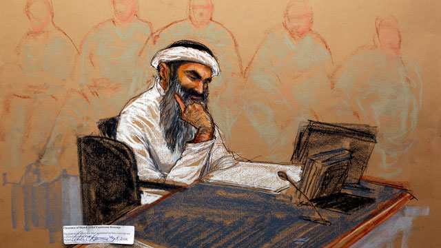 In this photo of a sketch by courtroom artist Janet Hamlin and reviewed by the US Department of Defense, Khalid Sheikh Mohammed reads a document during his military hearing at the Guantanamo Bay US Naval Base in Cuba, May 5, 2012.