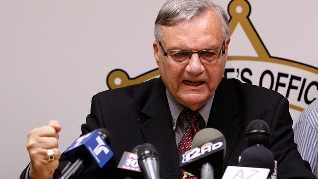 A defiant Maricopa County Sheriff Joe Arpaio, pounds his fist on the podium as he answers questions regarding the Department of Justice announcing a federal civil lawsuit against Sheriff Arpaio and his department. May 2012. (AP Photo/Ross D. Franklin)