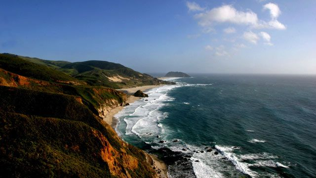 Waves crash against the cliffs of Big Sur, Calif. A new report says erosion could cause coastal cliffs to retreat more than 100 feet by 2100. April 2005. (AP Photo/Anja Schlein, FILE)