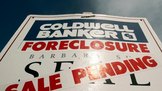 A foreclosed house sign with sale pending. March 2011. (AP Photo/Don Ryan)