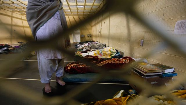 Afghan detainees are seen through mesh wire fence inside the Parwan detention facility near Bagram Air Field in Afghanistan. March 2011. (AP Photo/Dar Yasin, File)