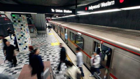 Commuters enter and exit a train at the MTA Red Line Hollywood/Western station in Los Angeles. April 2012. (AP Photo/Reed Saxon,File)