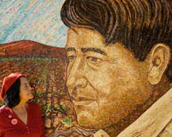Dolores Huerta with glass mosaic mural of César Chávez. Huerta and Chávez co-founded United Farm Workers. Photo: Robert Bain, SJSU Photographic Services.