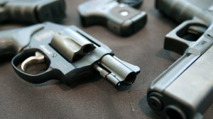 Smith & Wesson 442 and Glock 21 guns on display. May 2012 (AP Photo/The Grand Rapids Press, Cory Morse)