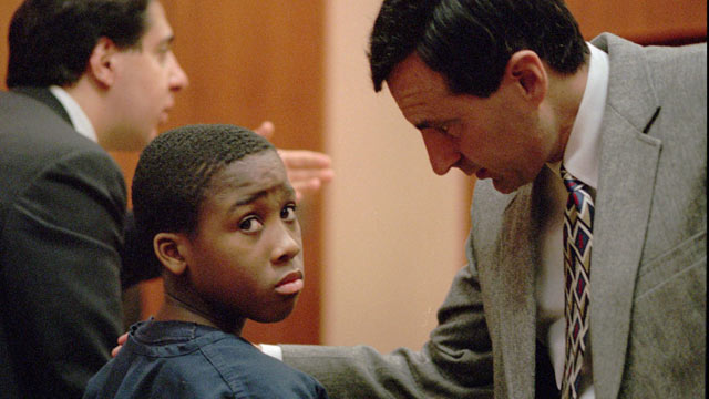 Nathaniel Jamal Abraham, 12, of Pontiac, Mich., listens to his attorney in Juvenile court in 1998. (AP Photo/Richard Sheinwald, File)