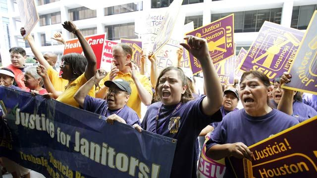 About 100 immigrant janitors marched through downtown Houston to protest a local cleaning company accused of withholding paychecks from its employees and not paying them for all hours they worked. June 2006 (AP Photo/David J. Phillip)