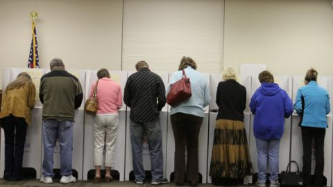 Voters cast their ballots in the general election in Star, Idaho. November 2010. (AP Photo/Charlie Litchfield)