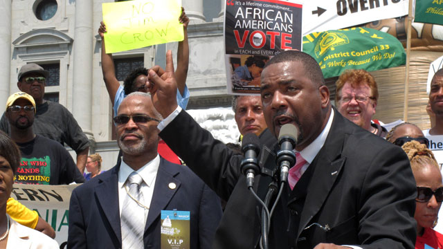 The Rev. Benjamin T. Hailey, president of the Pennsylvania Baptist State Convention, speaks during an NAACP-organized rally on the Capitol steps protesting the state's tough, new voter identification law on Tuesday, July 24, 2012 in Harrisburg, Pa. Democrats say the law is an election year stunt to steal the White House. Republicans say it's necessary to prevent voting fraud. (AP Photo/Marc Levy)