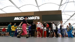 Olympic athletes queue up at the McDonalds inside the dining hall at the Olympic Village in London. July 2013. (AP Photo/Bullit Marquez)