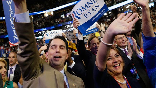 Wisconsin Gov. Scott Walker and his wife Tonette cheer as Republican vice presidential nominee, Rep. Paul Ryan addresses the Republican National Convention in Tampa, Fla., August 2012. (AP Photo/David Goldman)