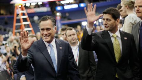 Republican presidential nominee Mitt Romney and his vice presidential running mate Rep. Paul Ryan, R-Wis. wave to their supporters after posing a group picture with their campaign staff at the Republican National Convention in Tampa, Fla., August 2012. (AP Photo/David Goldman)