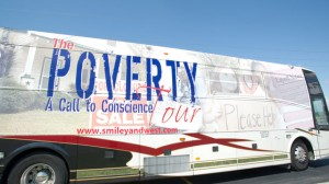 """The bus for radio co-hosts Tavis Smiley & Cornel West is on the road to Hayward, WI to kick-off 'The Poverty Tour: A Call to Conscience"""" in 2011. (AP Photo/Earl Gibson III)"""