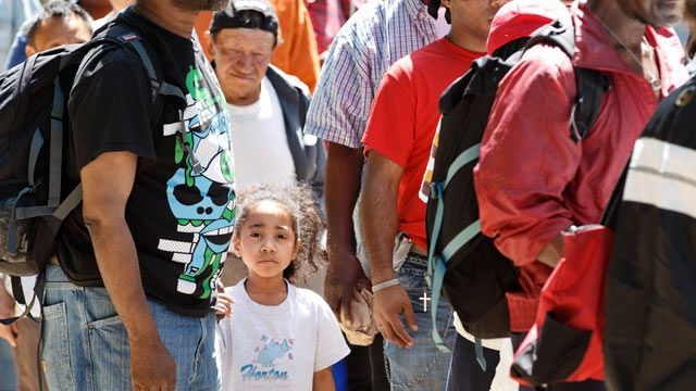 Homeless people line up in Franklin Park in downtown Washington to receive food and clothing from the congregation of Greater Saint John Church of Upper Marlboro, Md. May 2012. (AP Photo/J. Scott Applewhite)