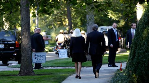 Guests walk towards the home of Melissa and Reeve Waud, the location of a private fundraising event with Republican presidential candidate Mitt Romney, in Lake Forest, Ill. September 2012. (AP Photo/Charles Dharapak)