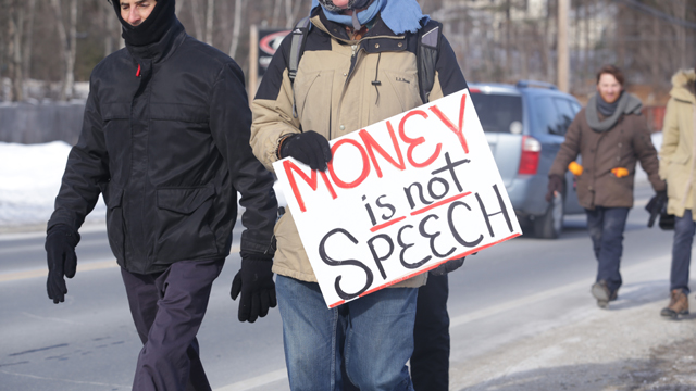A sign at the recent #NHRebellion march in which activist Lawrence Lessig and many others walked across the state to kick off a campaign to get big money out of politics.