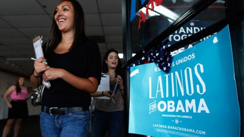 Volunteers for President Barack Obama's reelection campaign Carissa Valdez and Vanessa Trujillo as they leave campaign headquarters to register new voters in a heavily Latino neighborhood shopping plaza in Phoenix. June 2012. (AP Photo/Ross D. Franklin)