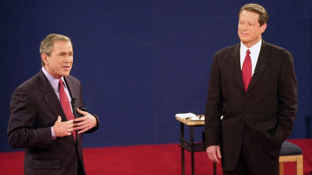 Republican presidential candidate, Texas Gov. George W. Bush speaks as Democratic presidential candidate Vice President Al Gore watches during their third and final debate at Washington University in St. Louis. October 2000. (AP Photo/Ed Reinke, File)