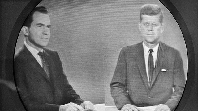 Vice President Richard M. Nixon listens as Senator John F. Kennedy talks during their televised presidential race debate. October 1960. (AP Photo)