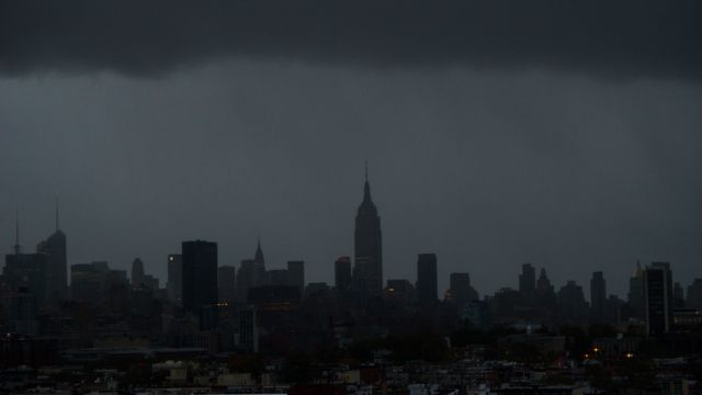 The Empire State Building and large portions of midtown Manhattan are seen without power as a result of Hurricane Sandy. October 2012. (AP Photo/Charles Sykes)