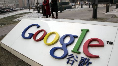 Women walk past the Google logo outside the Google China headquarters Beijing, China. January 2010. (AP Photo/Ng Han Guan, file)