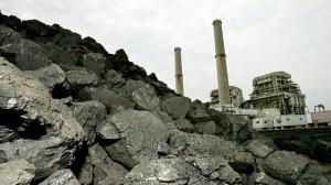 A pile of coal is shown at the TXU Corps Big Brown power plant near Fairfield, TX. August 2006. (AP Photo/David J. Phillip)