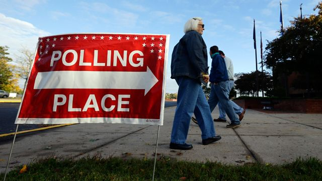 Voters arrive and depart during early voting at a polling place at the Wicomico County Youth and Civic Center in Salisbury, Md. October 2012. (AP Photo/Alex Brandon)