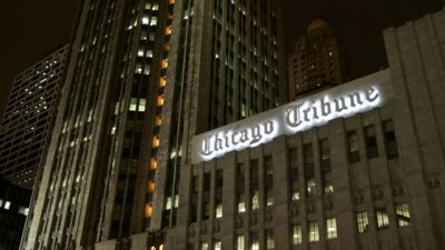 The Chicago Tribune Building with lights on. November 2005. (AP Photo/Jeff Roberson, File)
