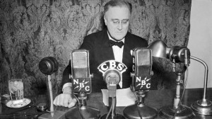 President Franklin D. Roosevelt shown at the White House, in Washington with an imposing battery of microphones lined up in front of him as he broadcast to the nation. January 1935. (AP Photo)