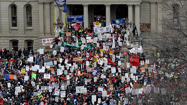 Protesters gather for a rally at the State Capitol in Lansing, Mich. protesting right-to-work legislation. December 2012. (AP Photo/Paul Sancya)
