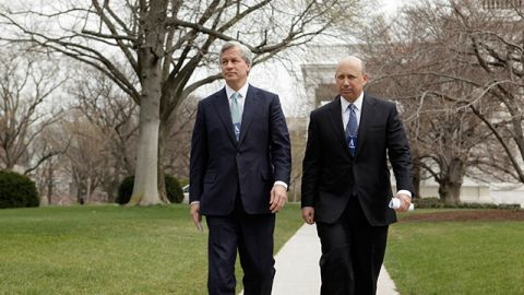 JP Morgan Chase & Co. Chief Executive Officer Jamie Dimon and Goldman Sachs Chief Executive Officer Lloyd Blankfein leave the White House in Washington following a meeting between chief executives and President Barack Obama. March 2009. (AP Photo/Evan Vucci)